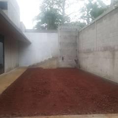 Vivienda en Fortín, Veracruz: Garajes de estilo  por escala1.4