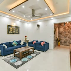 Gloryfields Apartment - Bangalore:  Living room by Wenzelsmith Interior Design Pvt Ltd
