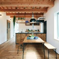 industrial Dining room by オレンジハウス