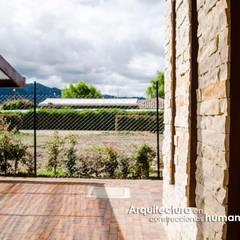CASA CANELON: Paredes de estilo  por DG ARQUITECTURA COLOMBIA