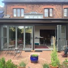Sun room conservatory extension to a stone barn:  Conservatory by Hargreaves: architecture+design
