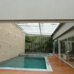Cobertura Parcialmente Retrátil: Telhados  por Belas Artes Estruturas Avançadas