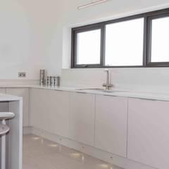 Matching Quartz up stands, splashbacks and window sills were added:  Built-in kitchens by ADORNAS KITCHENS