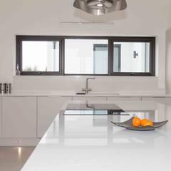 Minimalist Rural Home:  Built-in kitchens by ADORNAS KITCHENS