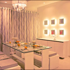 La tierra,Pune:  Dining room by H interior Design