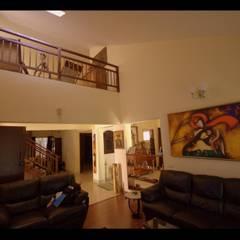 Captain Vijendra - Renovation: eclectic Living room by Sandarbh Design Studio