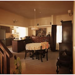 Captain Vijendra - Renovation:  Dining room by Sandarbh Design Studio