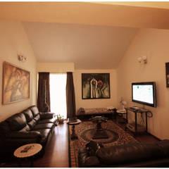 Captain Vijendra - Renovation:  Media room by Sandarbh Design Studio