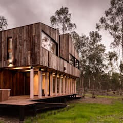 Log cabin by Dx Arquitectos