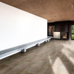 Sala in  pietra anticata a mano: Cantina in stile  di Viel Pietre