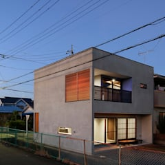 Single family home by 腰越耕太建築設計事務所, Asian Concrete
