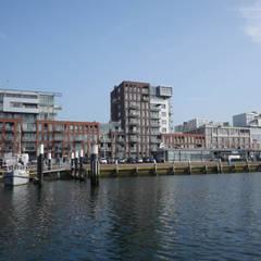 Havenmeester appartementen:  Meergezinswoning door Archipelontwerpers