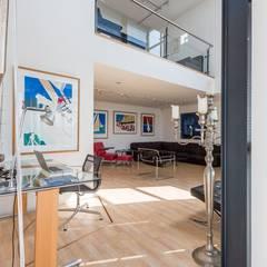 Penthouse Harbourview: moderne Woonkamer door Archipelontwerpers
