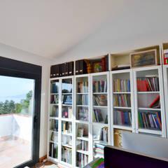 Estudios y despachos de estilo rústico por Famaser reformas y construcción