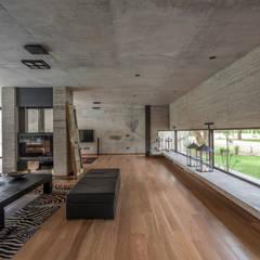 ห้องนั่งเล่น by Ciudad y Arquitectura