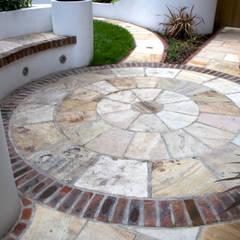 Sandstone circle:  Garden by Earth Designs