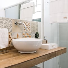 Banheiro: Banheiros  por INTERIOR - DECORAÇÃO EMOCIONAL
