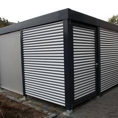 Cobertizos de estilo  por Carport-Schmiede GmbH & Co. KG - Hersteller für Metallcarports und Stahlcarports,
