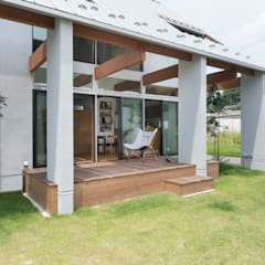 Konan House: ALTS DESIGN OFFICEが手掛けた木造住宅です。,ラスティック