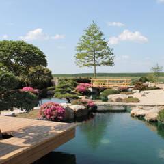 Lagoas de jardins  por Jürgen Kirchner Wasser + Garten