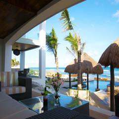 Villa Coquí Akumal: Terrazas de estilo  por DHI Arquitectos y Constructores de la Riviera Maya