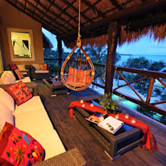 Sombras del Viento: Salas de estilo rústico por DHI Arquitectos y Constructores de la Riviera Maya