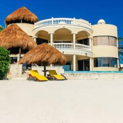 Villa Escapar: Villas de estilo  por DHI Arquitectos y Constructores de la Riviera Maya