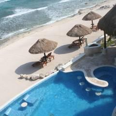 Переливные бассейны в . Автор – DHI Arquitectos y Constructores de la Riviera Maya