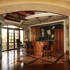 Casa Lasata: Cavas de estilo clásico por DHI Arquitectos y Constructores de la Riviera Maya
