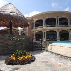 Piletas infinitas de estilo  por DHI Arquitectos y Constructores de la Riviera Maya