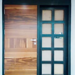Bunglow Interiors at Warje, Pune:  Wooden doors by Finch Architects