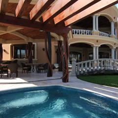 Akumal Palms : Casas unifamiliares de estilo  por DHI Riviera Maya Architects & Contractors