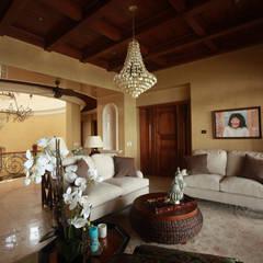Akumal Palms : Salas de estilo mediterraneo por DHI Riviera Maya Architects & Contractors