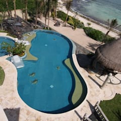 Infinity pool by DHI Riviera Maya Architects & Contractors, Tropical
