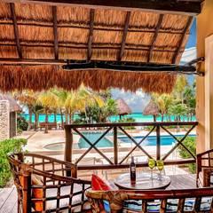 Sombras del viento: Terrazas de estilo  por DHI Riviera Maya Architects & Contractors