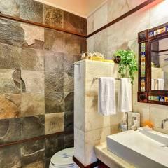 Sombras del viento: Baños de estilo  por DHI Riviera Maya Architects & Contractors