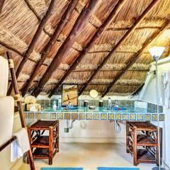 Sombras del viento: Baños de estilo  por DHI Riviera Maya Architects & Contractors, Rústico