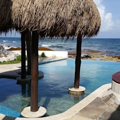by DHI Riviera Maya Architects & Contractors Tropical