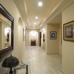 Hall: Pasillos y recibidores de estilo  por DHI Riviera Maya Architects & Contractors