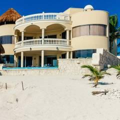 beachfront view: Baños de estilo  por DHI Riviera Maya Architects & Contractors