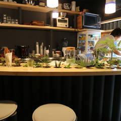 green stand: INTERIOR BOOKWORM CAFEが手掛けたオフィススペース&店です。