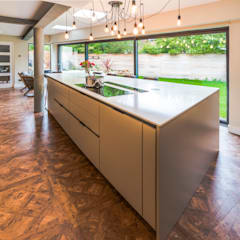 'Industrial' style extension and kitchen, proves that all things don't have to be rectangular!:  Built-in kitchens by John Gauld Photography