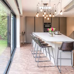 'Industrial' style extension and kitchen, proves that all things don't have to be rectangular!:  Kitchen units by John Gauld Photography