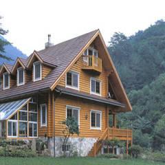 전원주택: (주)현대디자인건축의  목조 주택