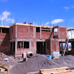 Construcción de casa Hacienda San Antonio (foto lateral): Casas unifamiliares de estilo  por Arkisav