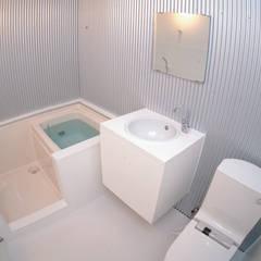 下板橋の家: 造形工房 平尾アトリエが手掛けた浴室です。