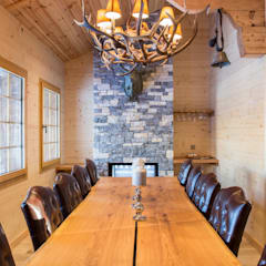 rustic Dining room by Prestige Architects By Marco Braghiroli