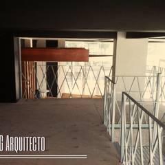"""BAR Y RESTAURANT """"U"""" ARQUITECTURA DE INTERIOR Y CONSTRUCCION: Bares y discotecas de estilo  por JLSG Arquitecto"""