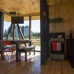 Cabañas Karku: Livings de estilo  por Nido Arquitectos, Rústico