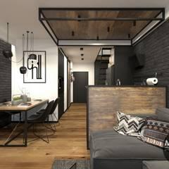 Jadalnia z salonem w klimacie industrialnym: styl , w kategorii Salon zaprojektowany przez MONOstudio